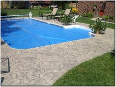 like the stamped concrete and border around pool | decorating--ext