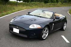 Jaguar XKR Convertible; 4.2L Supercharged V8 creating 420hp; the following generation (and current one) upgraded to a 5.0L supercharged V8 for 510hp; the XKR-S steps that up to 550hp
