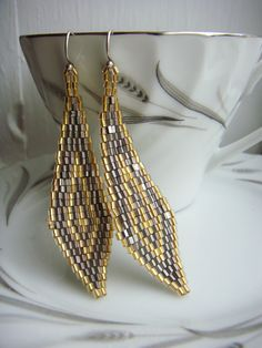 Stitched Chevron Earrings in 24K Lined Gold Seed beads and Palladium Seed Beads. $56.00, via Etsy.
