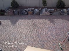 patio idea - rock wall in front