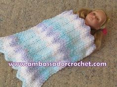 Free Pattern for Ripple 18″ Doll Blanket. Even a beginner can easily make this lovely little doll afghan using only the single crochet (sc) stitch.  Perfect Christmas gift for your little doll lover.