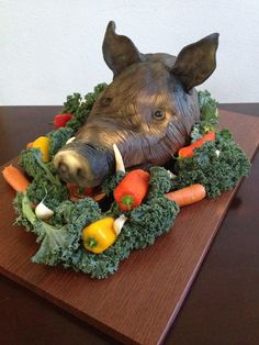 Boars Head Cake out of modelling chocolate and fondant accents