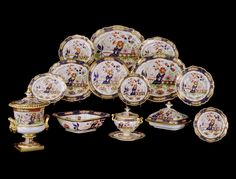* AN EXTENSIVE GEORGE IV WORCESTER PART DINNER SERVICE BY FLIGHT, BARR & BARR  A large early 19th century porcelain part dinner service by Flight, Barr & Barr, consisting of 96 pieces, all decorated with an Imari pattern, hand painted with pagodas and floral scenes against a white ground with a dark blue and gilt border punctuated with leaf and flowerhead panels.  Note: Decorated with Imari pattern with minor restorations to a few pieces.  English, circa 1825