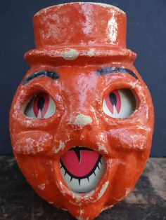 Vintage 1940's Halloween Jack-O-Lantern with Top Hat, made with Pulp Paper Mache. $129.00, via Etsy.