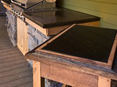 rescued barnwood and srap counter top to make outdoor for a cooking station