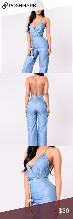 Lightweight denim jumpsuit I'm sad to let this one go! Lightweight denim material, adjustable straps with a wide leg trouser. Removable tassel belt. Fashion Nova Pants Jumpsuits & Rompers