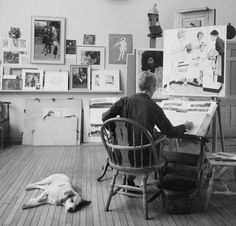 Norman Rockwell, in his studio with his dog.  http://en.wikipedia.org/wiki/Norman_Rockwell