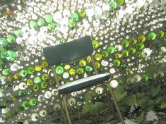 I've been saving Topo Chico bottles for a wall in my outdoor bathroom! I'll probably use the end-to-end method instead of leaving the necks exposed like this.