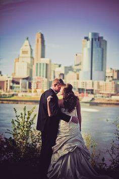 Destination Weddings: Bride and Groom sharing an intimate moment with the picturesque skyline (Photo by: Michael Bambino & Co.)
