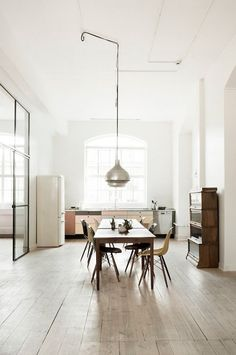 Follow Rent a Stylist http://www.pinterest.com/rentastylist/ large kitchen, white fridge, wooden table, lamp