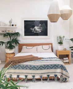 bohemian bedroom, plant on stump side table , rattan pendant lights