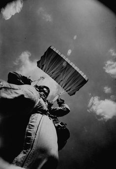 Photograph of a sky diver at Fort Bragg by Bob Gomel, 1968