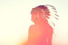 the original way to wear feathers in your hair. we should bring this look back.