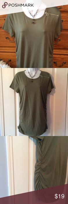 """Michael Kors Olive Green Top With Zipper 95% subprima cotton and 5% spandex.  Very good condition, just wore it twice.  No piling, rips or stains. Has silver tone logo as the side collar zipper and ruches up each side.  Approximately 28"""" in length and when laid flat and measured from armpit to armpit it is 18"""" across.  Has very good stretch.  The body of the top narrows down, it's more of a form fitting top. Nice soft smooth feel too! Michael Kors Tops Tees - Short Sleeve"""