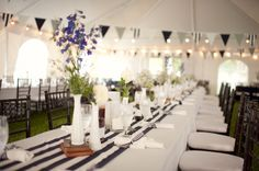 party idea <3! Navy striped table runner, milk glass and flags (plus yellow flowers).