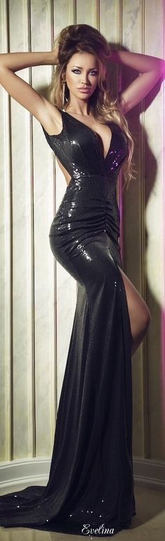 Black sequin gown with front baring slit