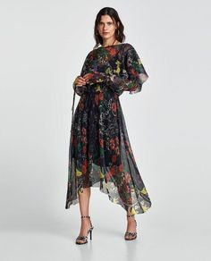 Turn heads at the wedding with this floral pleated dress.