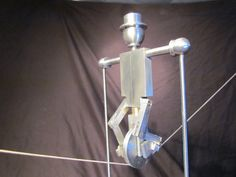 Unicycling Robot that Balances on a String