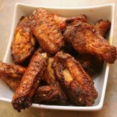 Chicken wings coated in a smoky dry rub - baked in the oven to crispy perfection. You won't stop eating until they're all gone. Just seven i...