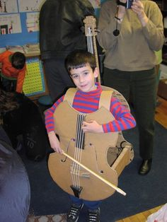Cello Costume I need to make this for Aaron for Halloween one year. (This year he's going as Superman, naturally. Maybe next year he can be Super Cello Dude.)