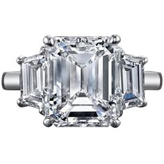 5.08 Carat GIA Cert Emerald Cut Diamond Platinum Three-Stone Engagement Ring | From a unique collection of vintage three-stone rings at https://www.1stdibs.com/jewelry/rings/three-stone-rings/