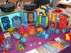 Naomi Southon's booth, she makes beautiful paintings, mosaics, and more, so her display has depth and height and LOTS of attractive color.