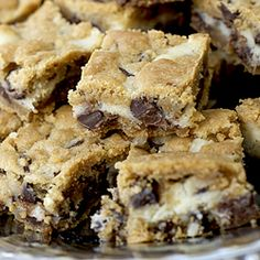 Chocolate chip cookie bars baked with a cream cheese layer in the middle. Rich and delicious.  Holycrap this looks like Heaven...