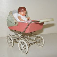 Miniature Pram 1950's with Baby Doll.      My little sister had a doll buggy like this one. We had a lot of fun playing with it.
