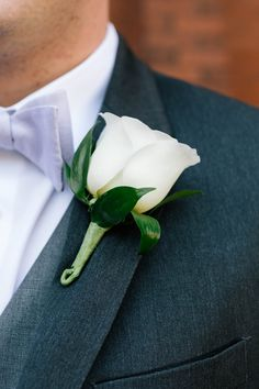 A very classic boutonniere for a classic groom! Design by Holliday Flowers and Events. Photo credit: Smash Studios Photography.