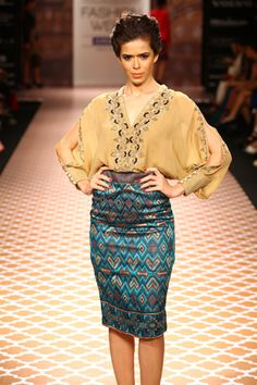 pencil skirts(less shiny ) and looser but well draped tops(stitch up the cuts) and you are ethnic and chic!