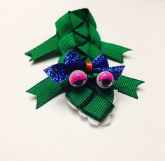 Alli the gator with a blue bow! Available on Little Honey Darlin Face on Facebook! $5.00 or $10 on a halo headband https://www.facebook.com/littlehoneydarlinfaceboutique?ref=bookmarks