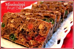 Mississippi Fruit Cake  --  baked version with oil, brown sugar, eggs, flour, baking powder, salt, spices, orange juice, candied pineapple, candied red and green cherries, raisins, dates, chopped walnuts, chopped pecans, whole pecans.