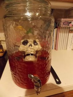 Blood Punch  (This was a big hit at our Oct. Bunco)  1 large jug of Fruit Juicy Red Hawaiian Punch, 2 liters of Ginger Ale, 2 cans of frozen pink lemonade -mix together and serve with plastic bugs, skull, or body parts.