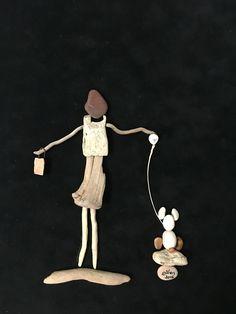 Driftwood and pebble art gülen