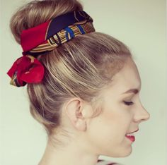 Tie your favorite silk scarf around a top knot for a fun look that helps hide second-day dirty hair.
