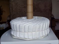"one basic way to lay out a ""wheel"" for a diaper cake"
