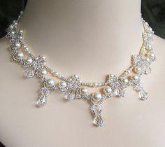 Cream Swarovski Pearls, Clear Swarovski Crystal with silver beading.  The Swarovski teardrops