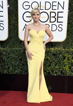 Reece Witherspoon wears yellow strapless gown at the Golden Globes.