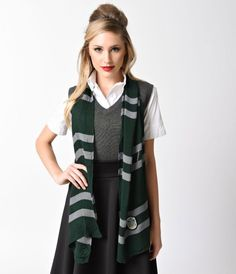 Show off your house colors, dames! This cunning emerald green and silver grey stripe scarf is the perfect addition to a magical wardrobe, whether you wear it to shield you from the enchantments or simply to charm a basic school uniform. An embroidered pat