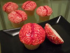 Cherry Vanilla Zombie Treatsby CandyCasters, for zombies with a sweet tooth:    Vanilla cupcakes with chunks of maraschino cherries, cherry vanilla butter cream frosting and brain cupcake toppers made with Lindt white chocolate painted with cocoa butter.    [via That's Nerdalicious!]