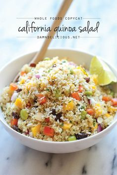 Whole Food's California Quinoa Salad - A healthy, nutritious copycat recipe that tastes 1000x better than the store-bought version!  Mango, bell peppers, edamame, red onion, almonds, coconut flakes, raisins, cilantro = YUM!