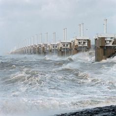 The Delta Works consist of nine dams and four barriers which were built between 1958 and 1997 in the Dutch Provinces of Zeeland, South-Holland and North-Brabant. Delta Works, Flood Barrier, South Holland, Storm Surge, World Water, Seven Wonders, Holiday Travel, Wonders Of The World, Places To See