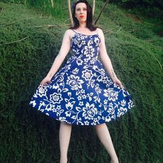 """De Weese Design 1960s Dress. Blue And white abstract floral Hawaiian dress, vintage 1960s. Built in bra elasticated back. The size tag reads 11/12 but the model is an 8, this could fit up to a 12. This piece is in wonderful condition except for a quarter of an inch brown spot which took me fifteen minutes to find. I'm almost certain a trip to the dry cleaners will take care of it. Here are approximate measurements: B 26"""" Flat, 34"""" Stretched, W 22"""" Flat, 28"""" Stretched, Hips Free, Length 37""""…"""