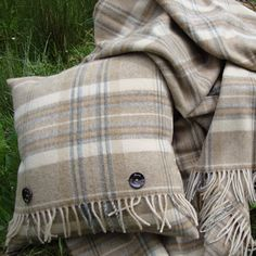 <p> 	A fabulous and practical merino wool cushion to compliment the popular Natural Heather Check blankets, a wonderful wedding gift or house warming gift.</p>