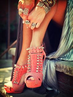 Edgy Chic  Studs and spikes look totally unexpected on a pair of coral heels. Pair with chunky silver and gold jewelry -- but keep the rest of your outfit simple, by wearing something like a gray maxi dress.