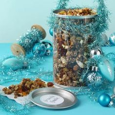 Great Granola Recipe- Recipes  Granola goes glam when stowed in a see-through container decked out with tinsel. Nuts, dried fruit and more make a crunchy mix for topping oatmeal or eating by the handful. Tie on mini holiday bulbs fancied up with a metallic paint. —Johnna Johnson, Scottsdale, Arizona