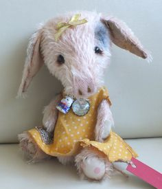 """""""Pixie"""" the Gloucester Old Spot piglet with dress, charm and bell. By Ragtail n Tickle."""