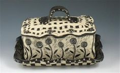 Sgraffito Pottery:  The following work is formed by hand, on the potters wheel or by sculpting, using porcelain or stoneware. Description from pinterest.com. I searched for this on bing.com/images