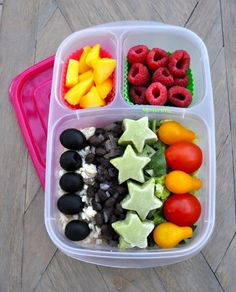 Black beans, rice, olives, tomatoes, greens, frozen guacamole stars and fruit for school lunch in @EasyLunchboxes