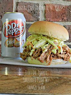 Crock pot shredded pork w/ tangy slaw on top, yum!  Perfect for Memorial Day picnic.  #shredded pork